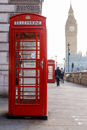 Traditional London red phone box and Big ben in early winter morning Stock Photo
