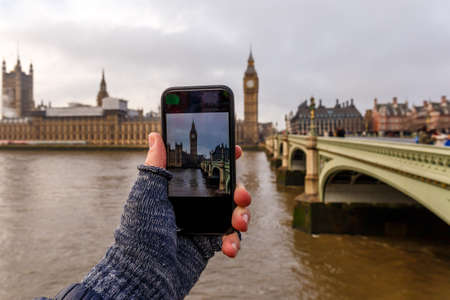 Taking and posting photo of Big ben in winter morning, London