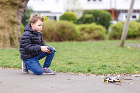 School boy with quadrocopter inthe park, London Stock Photo