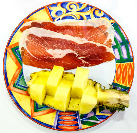 Jamon and Pineapple in the plate Stock Photo