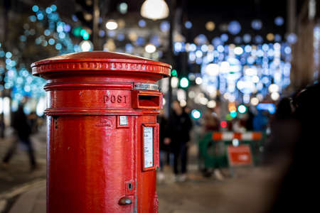 Classic London post box  on the Oxford street in Christmas time