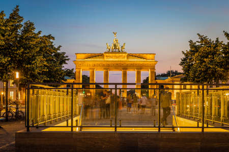 Brandenburg gate after the sunset in summer, Berlin Фото со стока
