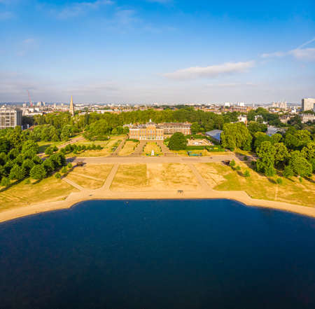 Aerial view of Kensington palace and round pond in Hyde park, London