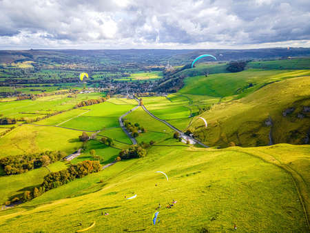 Paragliding in Peak district, an upland area in England at the southern end of the Pennines, UK