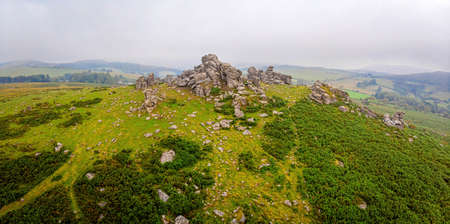 A view of Hound Tor in Dartmoor National Park is a vast moorland in the county of Devon, in southwest England, UK