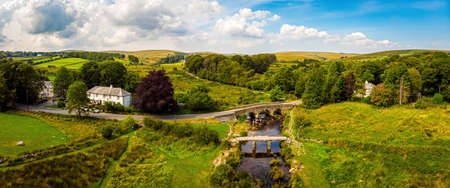 A view of Postbridge Clapper Bridge in Dartmoor National Park is a vast moorland in the county of Devon, in southwest England, UK