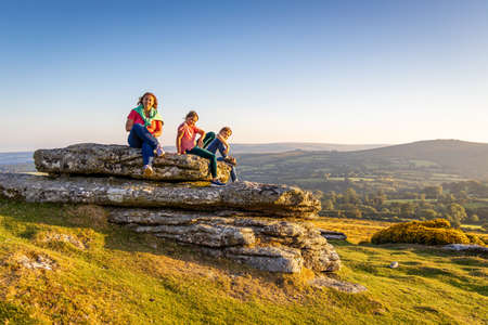 Family in Dartmoor national park in the evening, UK