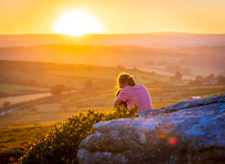 Kid in Dartmoor national park in the evening, UK