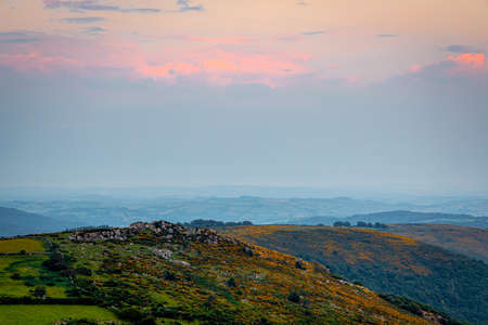 Sunset view of Dartmoor National Park, a vast moorland in the county of Devon, in southwest England, UK