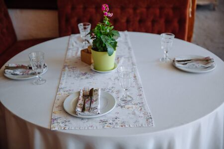 Table setting in the restaurant. A fragment of the interior.