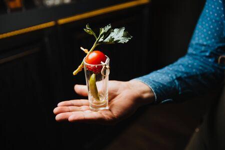 Drink glass in hand. Stok Fotoğraf
