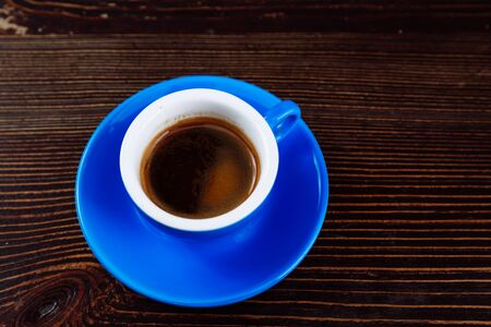 Blue cup of coffee on a wooden background. Stok Fotoğraf