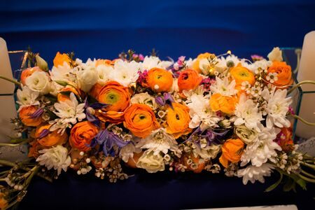Composition from fresh flowers on a banquet table. Stock Photo