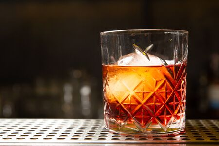 Whiskey with an ice ball in a glass. Ready to eat. Reklamní fotografie