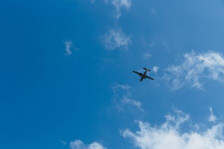 Airplane in the sky on a sunny day.