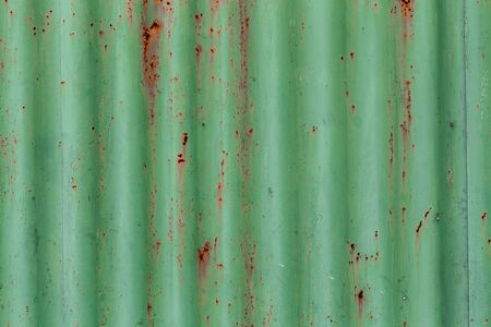 Corrugated metal texture or iron steel texture with traces of rust, Green Colour, Abstract Background.