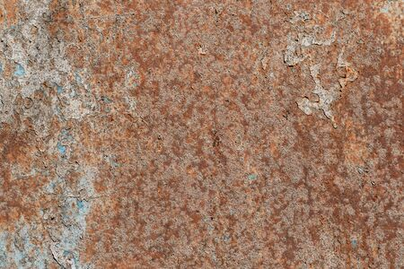 Texture of old rusty metal sheet and peeling blue paint. Abstract background.