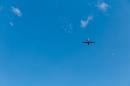 Airplane in the sky on a sunny day. Copy space.