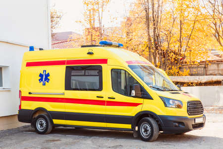 Zaporozhye/Ukraine- November 08 2019 :Yellow ambulance stands in the courtyard of the hospital: side view.
