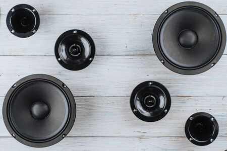 Car audio, car speakers on a white wooden background. Copy space Archivio Fotografico