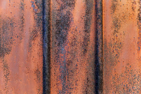 Texture of fluted rusty metal plate. Corrugated.