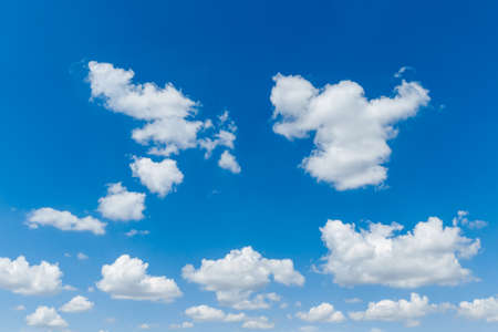 Blue clear sky with white fluffy clouds. Natural background. Stock Photo
