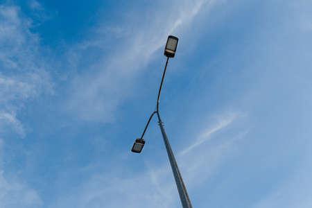 Street lantern on sky background.A modern street LED lighting pole. Copy space Banco de Imagens