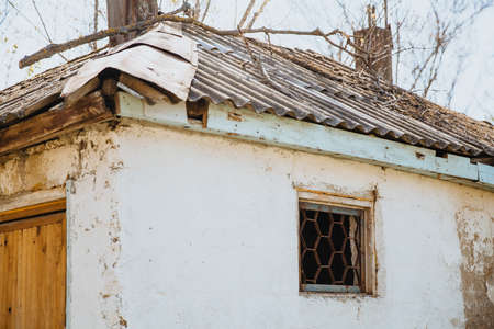 An old run down, weather beaten house that is in need of repair, housing problems.