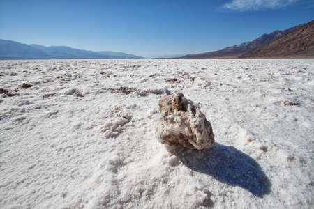 view of rock in the lake of salt in death valley national park, california photo