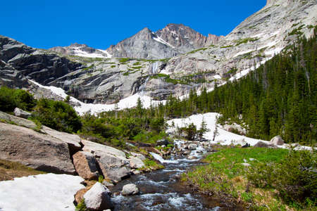 Glacier and mountain river in summer, Rocky Mountains National Park, USA photo