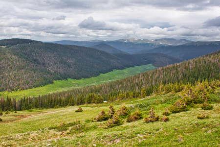 Lava Cliffs in Rocky Mountains, alpine meadow in summer