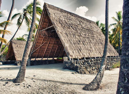 primitive tropical shelter in Hawaii at place of refuge photo