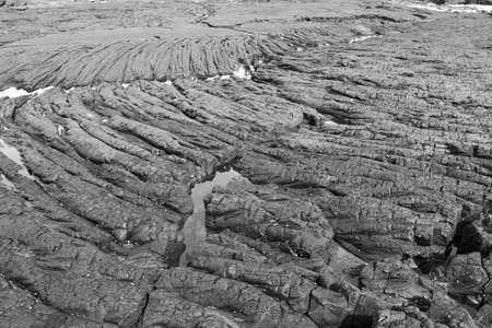 lava formations on the beach in Hawaii photo