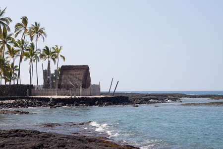 primitive hut at the place of refuge in Hawaii big island photo