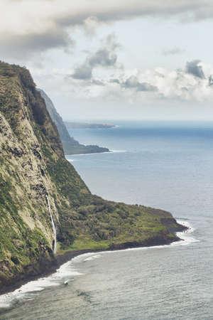 Waipio valley in Hawaii big island during cloudy day photo