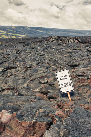 Road closed sign and highway damaged by lava in Hawaii photo