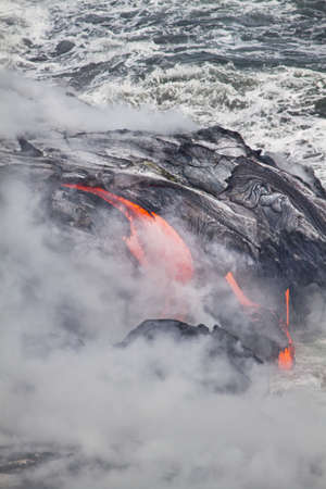 Lava erupting into Pacific Ocean in Hawaii Big Island photo
