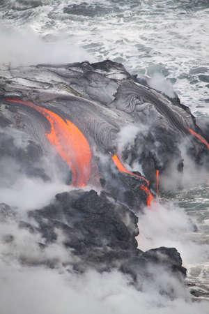 Lava erupting into Pacific Ocean in Hawaii Big Island Stockfoto