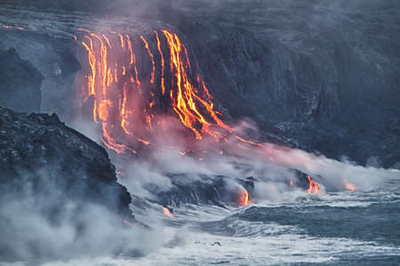 hawaii: Lava erupting into Pacific Ocean in Hawaii Big Island Stock Photo