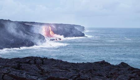 kilauea: Lava erupting into Pacific Ocean in Hawaii Big Island Stock Photo