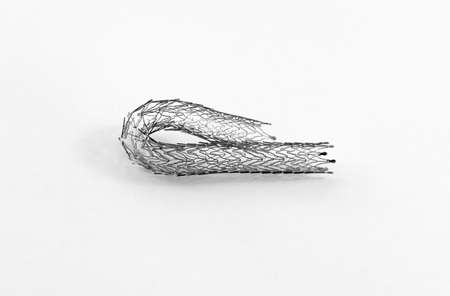 open-cell self-expanding nitinol stent for endovascular surgery bent on itself Stock Photo - 15926000