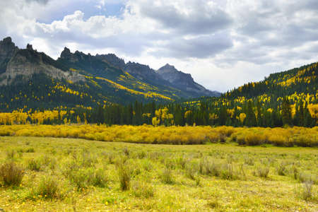 Pinnacle Ridge on Owl Creek Pass with golden and green aspen during fall in Colorado photo