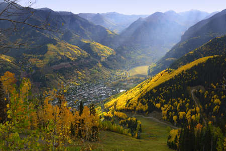 aspen leaf: overlook over Telluride with golden, green and red aspen in Colorado