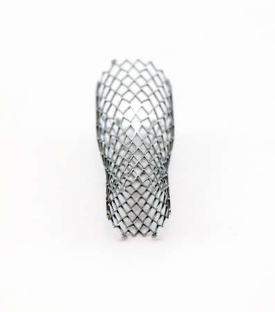 stenosis: mesh metal nitinol self-expandable stent for endovascular surgery Stock Photo