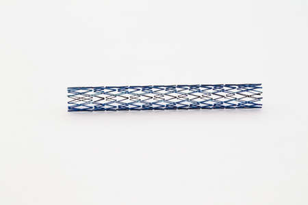 aneurism: mesh metal stent for endovascular surgery Stock Photo