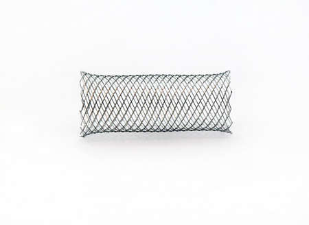 nitinol: braided mesh metal stent for endovascular surgery Stock Photo