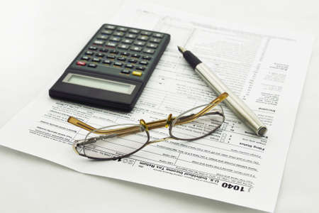 preparation of Internal Revenue Service form 1040 for income report and US tax return Stock Photo - 17111291