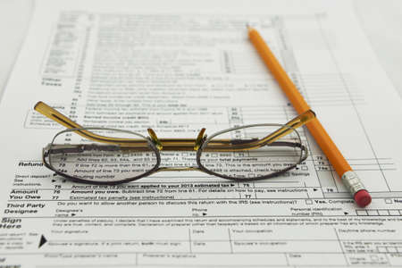 preparation of Internal Revenue Service form 1040 for income report and US tax return Stock Photo - 17111122