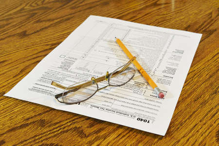 preparation of Internal Revenue Service form 1040 for income report and US tax return Stock Photo - 17111168