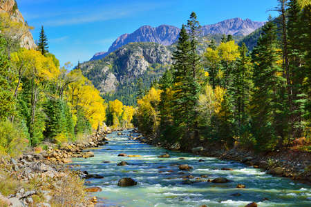 river and colourful mountains of Colorado during foliage season